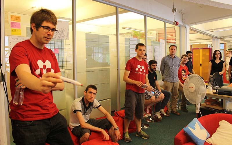 The Mendeley team, with Software Engineer Carles Pina at left, gathers to discuss ideas before a Hack Day starts.