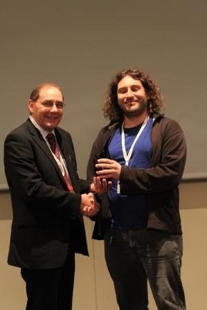 Prof. Richard Luxton (left) presenting the poster award to Dr. Stefan Schrittwieser (right)