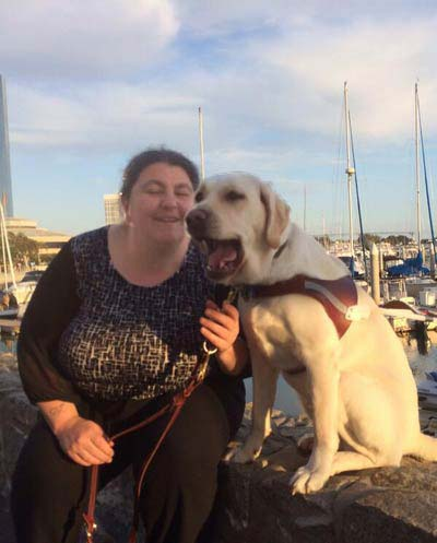 Lucy Greco and her seeing-eye dog, Frances, in San Diego, California during this year's International Technology and Persons with Disabilities Conference in March.