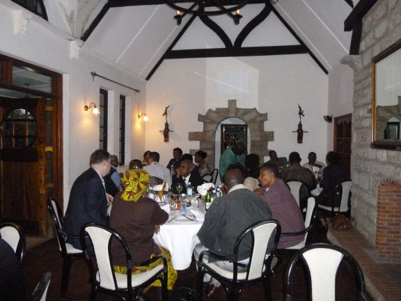Conference delegates continue the conversation over dinner at a local restaurant in Nairobi