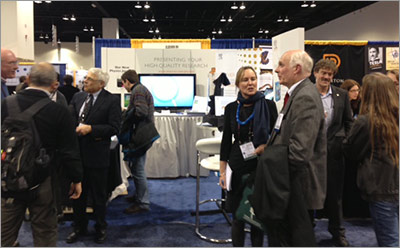 Dr. Charon Duermeijer, Publishing Director and Head of Elsevier Physics Journals, talks to a delegate at Elsevier's booth at the 2014 American Physical Society meeting.