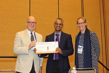 Stephen Neidle and Diddel Francissen presenting the award cheque to Shankar Balasubramanian
