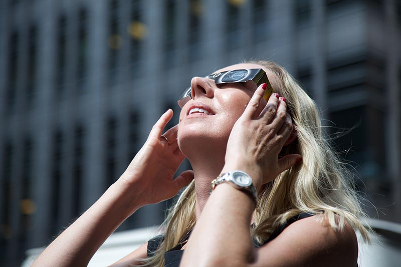 Liz Perill, Executive Publisher, Health Sciences at Elsevier, watches the eclipse.