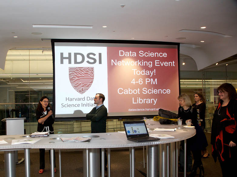 Prof. Francesca Dominici and Prof. David Parkes, Co-Directors of HDSI, summarize their groups' insights and recommendations at the networking reception in Cabot Science Library. (Photo by Alison Bert)