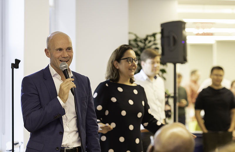 Dominic Feltham, President of Research, talks with employees about research strategy at Elsevier. (Photo by Alison Bert)