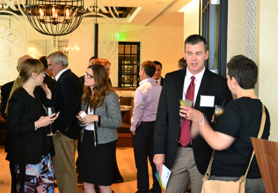 Stephanie Huie, PhD, Vice Chancellor for the Office of Strategic Initiatives, University of Texas System, and David Troutman, Director for the Office of Strategic Initiatives, mingle with representatives from the university system, local government agencies and the private sector prior to the launch program.