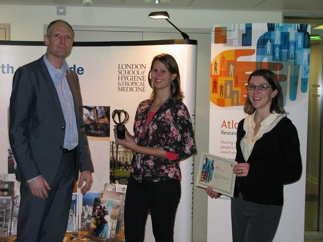 Katie Greenland receiving her Atlas Award from Zoë Mullan, Editor-in-Chief, The Lancet Global Health and Floris de Hon, Publishing Director, Life Science Journals