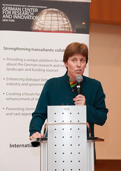 Joann Halpern, PhD, moderates a panel at the German Center for Research and Innovation in New York. (Photo by Nathalie Schueller)