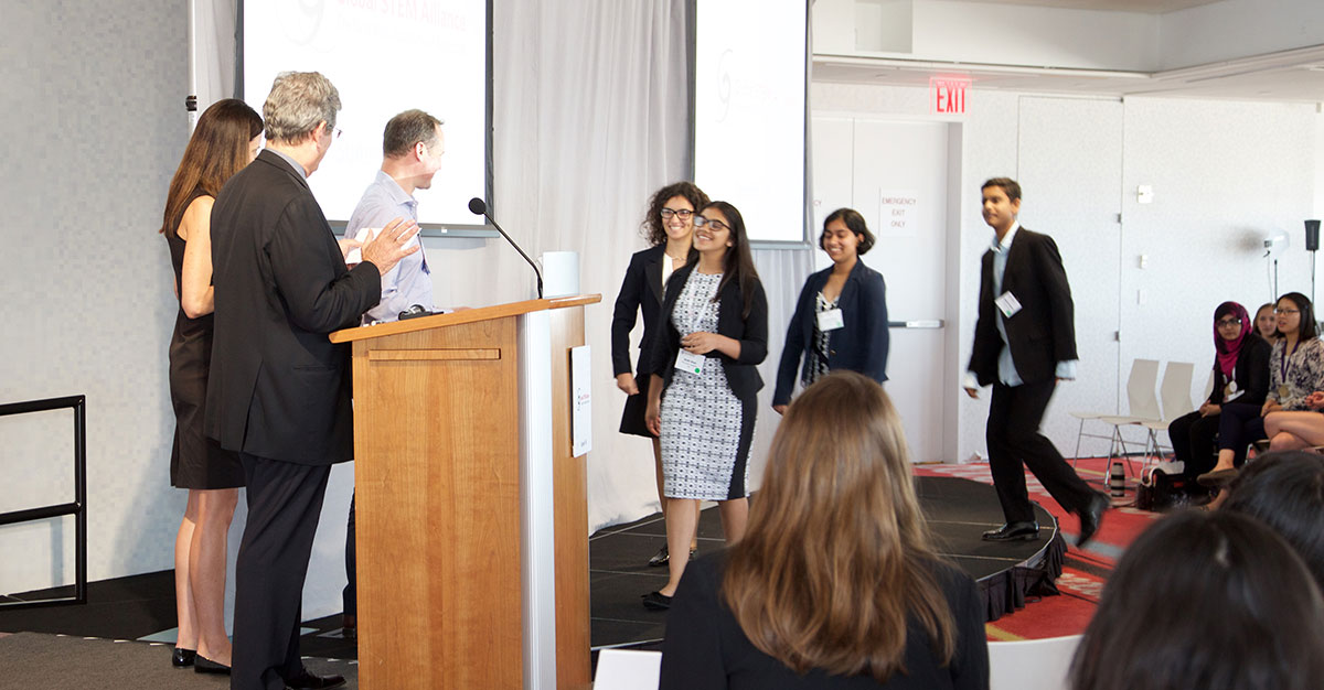 Team AquaeVitae accepts their award at the Global STEM Alliance Summit (Photo by Alison Bert)