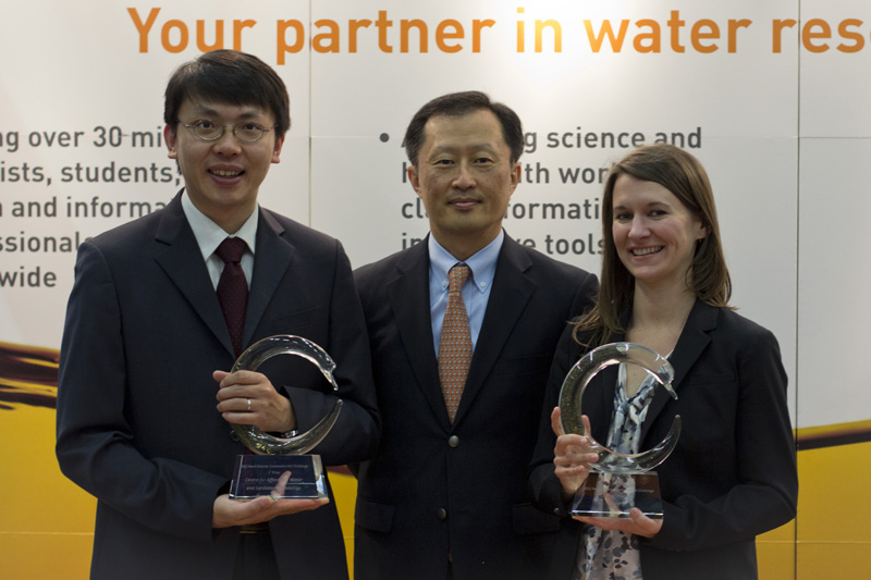 Youngsuk 'YS' Chi, Director of Corporate Affairs for Reed Elsevier, with winners Tommy Ngai, Director of Research Learning, CAWST, and Lindsay Stradley, Operations & Consumer Marketing, Sanergy (Photo by Fredrik Sjögren)