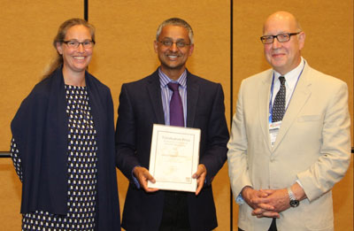 Dr. Diddel Francissen, Executive Publisher, Tetrahedron Publications (left), and Professor Stephen Neidle, University College London School of Pharmacy (right), present the award certificate to Professor Shankar Balasubramanian.