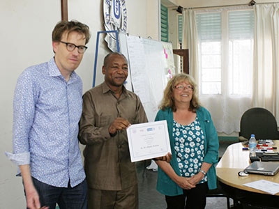 Theun Fleer, left, and Geraldine Lovell presented certificates to Dr. Rex Justine Kidyalla and other workshop participants on the final day of the program at the University of Dodoma. (Photo by Maaike Duine)