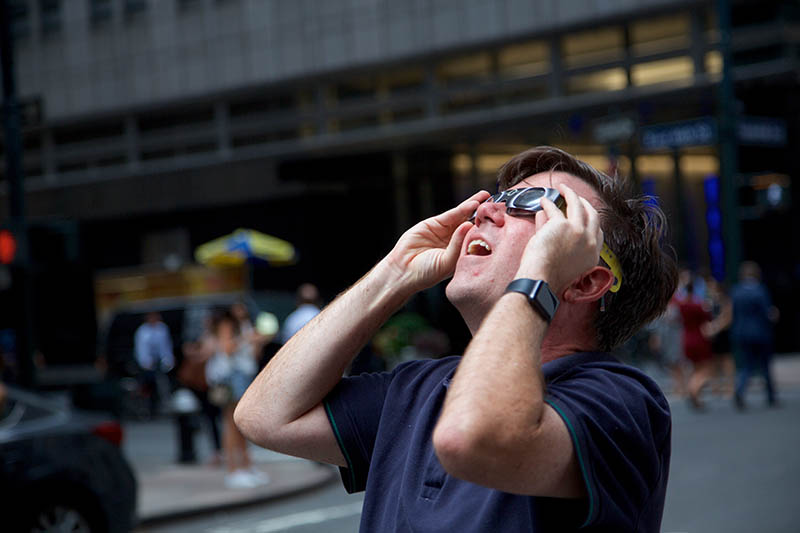 Jason Awerdick, Marketing Communication Manager for Elsevier's Life Science journals, watches the eclipse in New York.