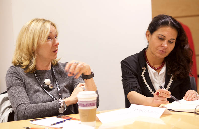 Dr. Sharon-Lise Normand, Professor of Health Care Policy (biostatistics), speaks as Dr. Francesca Dominici, Professor of Biostatistics and HDSI Co-Director, takes notes in the roundtable on behavioral determinants of health. (Photo by Alison Bert)
