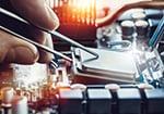 Engineer fixing computer