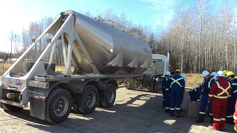 "A truck carrying ""proppant"" — the material, usually sand, used to prop open the cracks made by hydraulic fracturing (Photo by Mike Stephenson)"