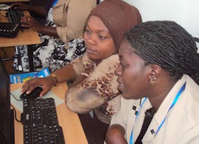 In a Collaboration for Evidence Based Healthcare in Africa (CEBHA) workshop in Tanzania, two participants work together at a computer to search for evidence. (Photo by Dr. Frode Forland)