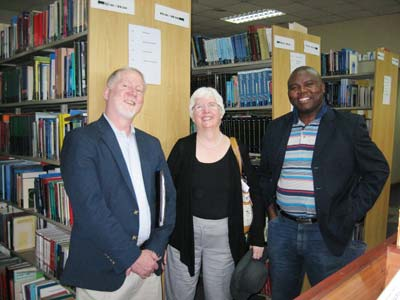 Michael Driscoll and Anne Linton of George Washington University with Diston Chiweza, Director of the Library at the University of Malawi College of Medicine.