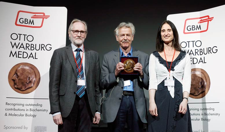 At the Otto Warburg Medal award ceremony: Professor Roger Goody, President of GBM; Professor Rudolf Jaenisch, winner of the 2014 award; and Dolors Alsina, Executive Publisher of Life Sciences at Elsevier.