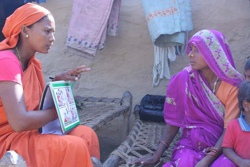 A health worker providing health education for a woman in Nepal. Even the most basic healthcare knowledge depends indirectly on access to research. (Photo © 2009 Ben Barber, courtesy of Photoshare)