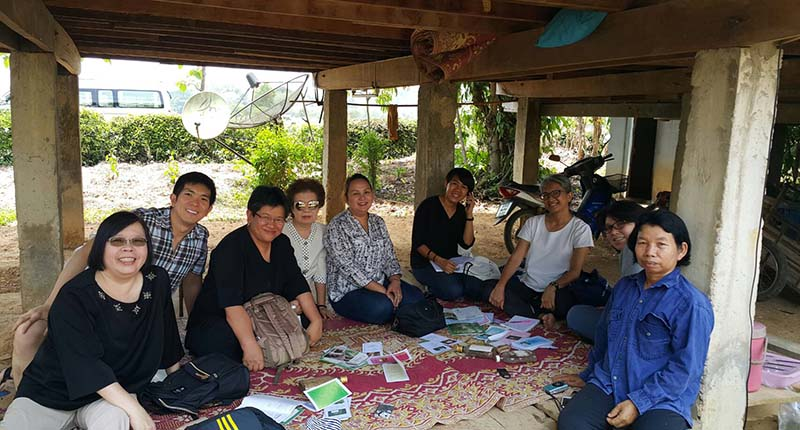 Dr. Sukanda Luangon Lewis (third from left) with her research team and a local farmer in Nan (right).