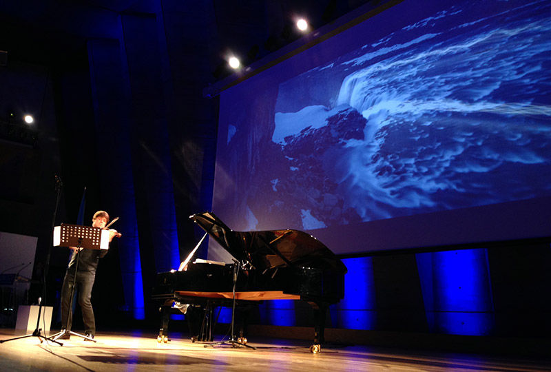 Grammy Award-winning violinist Joshua Bell performed the world premiere of music from Bruce Adolphe's score for <em>Einstein's Light </em>yesterday at the United Nations/UNESCO International Year of Light Opening Ceremony in Paris. (Photo by Charon Duermeijer, PhD)