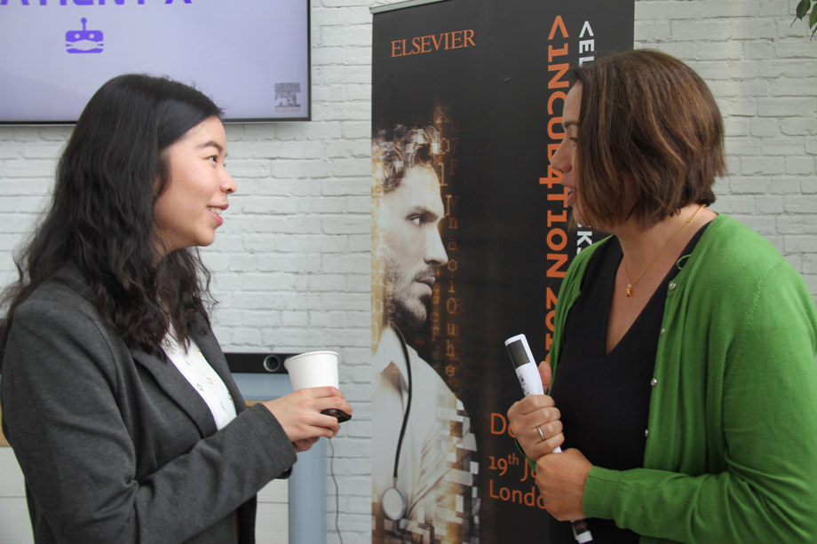 Alice Talking to One of the Judges at Elsevier Hacks Incubation 2018 Demo Day
