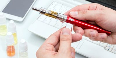 What are the potential harms and benefits of e-cigarettes?