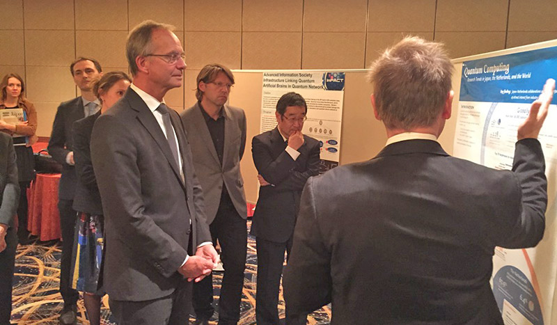 Anders Karlsson, PhD (back facing), Elsevier's VP of Global Academic Relations for Asia Pacific, showcases Scopus's capability to illustrate Japanese-Dutch strengths and collaborations in quantum computing and quantum information to Dutch Economics Minister Henk Kamp. Looking on is Dutch National Science Icon and QuTech Director Prof. Leo Kouwenhoven from Delft University of Technology (in light gray jacket). Also present is Prof. Yoshihisa Yamamoto, top Japanese scientist in quantum physics and project manager of one of several high-visibility ImPACT projects. The seminar was arranged by the Netherlands Office of Science and Technology in Tokyo.