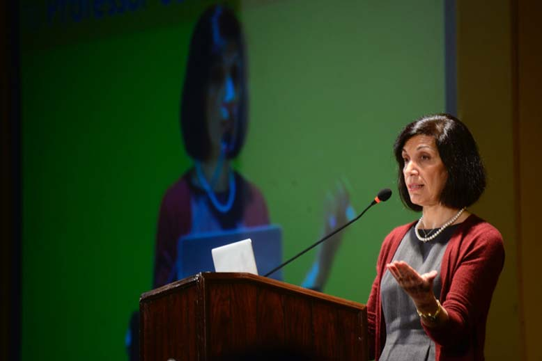 Huda Zoghbi, MD, gives a lecture in Chennai as part of the Cell Press–TNQ India Distinguished Lectureship Series. (Photo courtesy of TNQ)