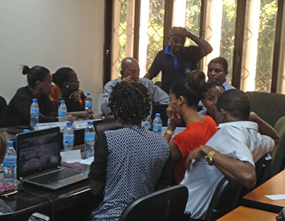 During lively conversations, attendees from Ardhi University, Law Africa, Read It Publishing, University of Dar es Salaam, and Muhimbili University help each other relate the books publishing training to their own work. (Photo by Shirley Decker-Lucke)