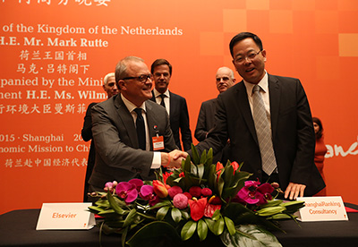<strong>Elsevier signs an agreement to deliver data and analytics to the ShanghaiRanking Consultancy (SRC).</strong> Front row: Dr. Philippe Terheggen, Managing Director of STM Journals at Elsevier, with Prof. Dr. Nian Cai Liu, PhD, Chairman of the Board of SRC, Director of the Center for World-Class Universities, and Dean of the Graduate School of Education at Shanghai Jiao Tong University. Looking on (left to right) are Wilma Mansveld, State Secretary of Infrastructure and Environment in the Netherlands; Prime Minister Mark Rutte of the Netherlands; and Aart Jacobi, Dutch Ambassador to China.