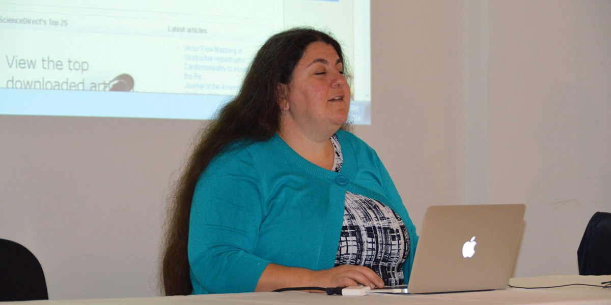Lucy Greco, a web accessibility expert at UC Berkeley, demonstrates the accessibility features of ScienceDirect during a RELX Corporate Responsibility Forum.