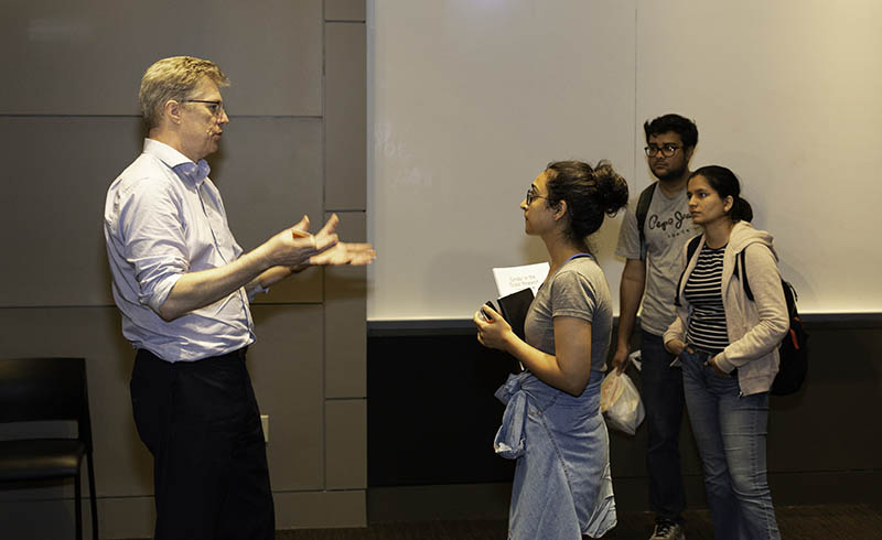 Ron Daniel talks with Simran Lamba, who graduated recently with an MS in Data Science from Columbia University. (Photo by Alison Bert)