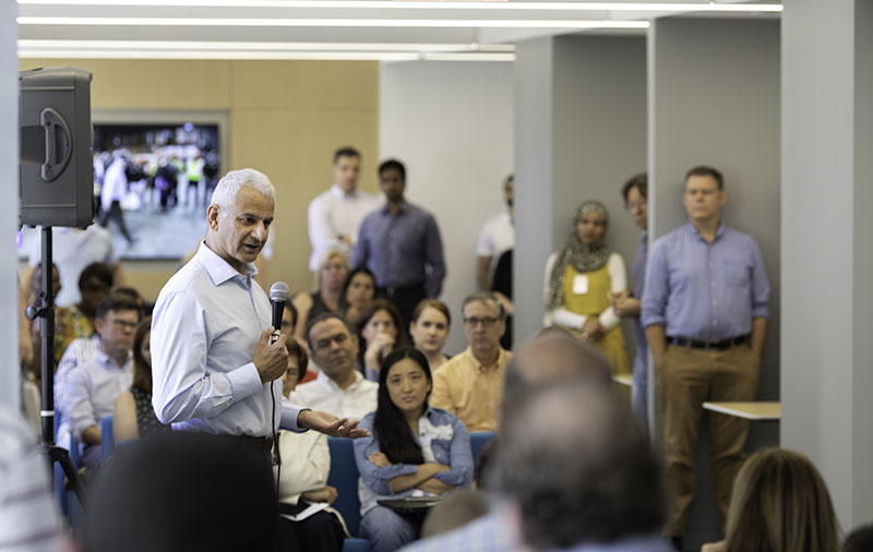 Ron Mobed talks with employees in New York at a recent townhall. (Photo by Alison Bert)