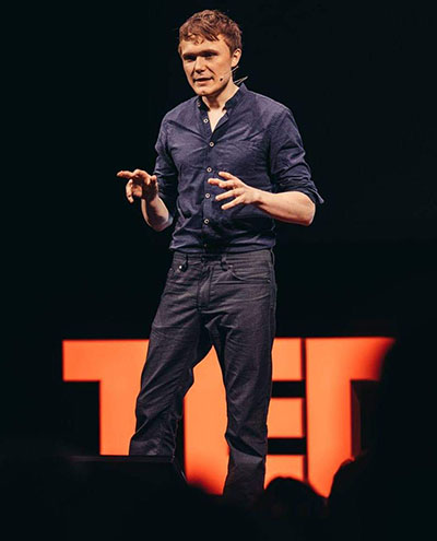 "At TEDxOdense 2018, machine learning researcher Alexander Mathiasen takes his audience ""into the mind of idiot computers — and idiot people."""