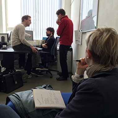 Figure 2:  Heather Williams watches researchers as they perform data analysis on a preliminary data set.