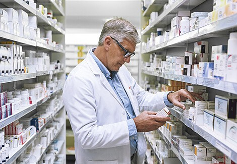 Pharmacist examining drugs