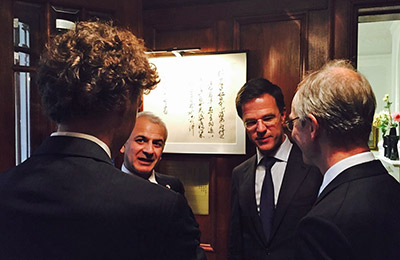 Ron Mobed (second from left) with Dutch Prime Minister Mark Rutte (third from left), Henk Kamp, Dutch Minister of Economic Affairs (fourth from left) and Jasper Wesseling (first from left), Deputy Director General from the Ministry of Economic Affairs, engaged in a discussion at the Dutch Ambassador's residence in Tokyo.