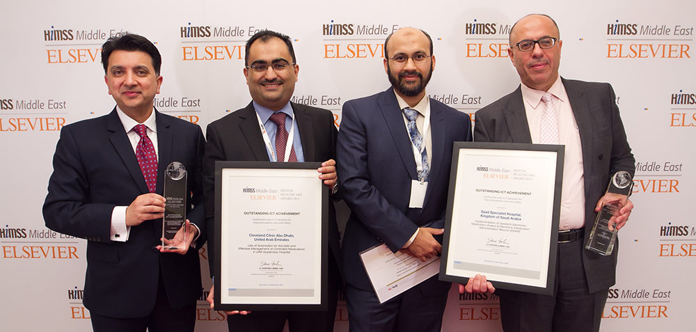 Leaders of the Cleveland Clinic Abu Dhabi and Saad Specialist Hospital receive the HIMSS-Elsevier Digital Healthcare Award (Credit: Gabriel John Rimando)