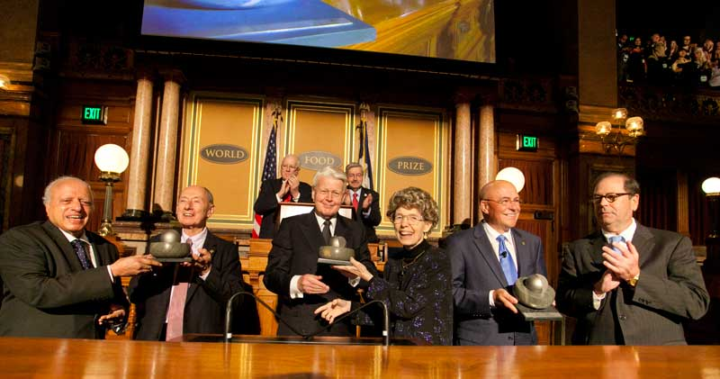 The 2013 World Food Prize Laureates receive their awards. From left to right: Dr. MS Swaminathan, Chairman of World Food Prize Selection Committee; Laureate Marc Van Montagu, PhD; President of Iceland Olafur Ragnar Grimsson; Laureate Mary-Dell Chilton, PhD; Laureate Robert T. Fraley, PhD; and John Ruan III, Chairman of the World Food Prize Foundation.