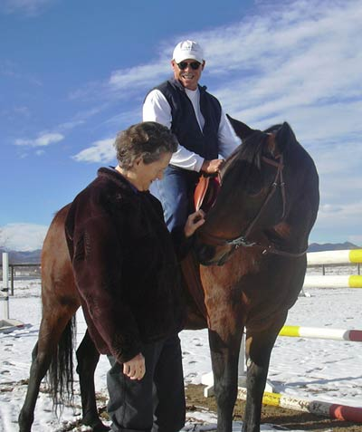 Temple Grandin visits Mark Deesing on his ranch. He is sitting on his horse Amy, a German Warmblood show jumper. This photo is on the front cover their book. (Photo by Kelly Mozetta)