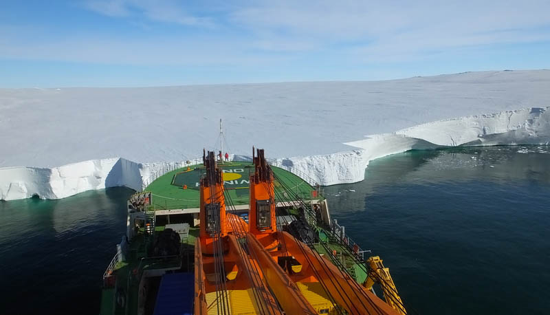 In January, the Akademik Tryoshnikov anchoris alongside the Mertz glaciar to deploy equipment. (Photo by Jen Thomas)