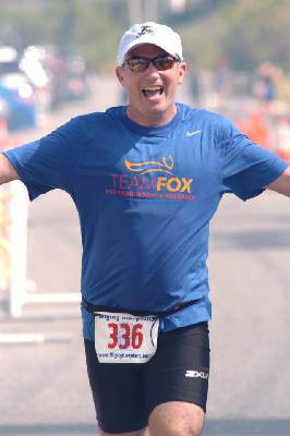 Bret Parker finishes a triathlon in 2014 to raise money for the Michael J. Fox Foundation for Parkinson's Research.