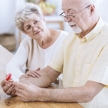 Senior couple looking at drug information