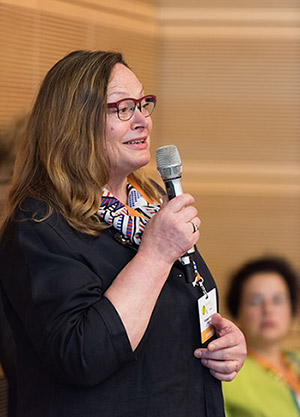 Elizabeth Pollitzer, PhD, an architect and organizer of the Gender Summits, introduces the speakers at GS7. (Photo © Ben Pollitzer)