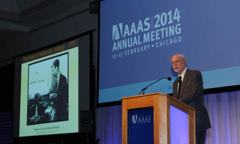 AAAS President Phillip A. Sharp, PhD, shows a slide of Watson and Crick while giving a brief history of advances in life sciences and the resulting innovation. (Photo by Alison Bert)
