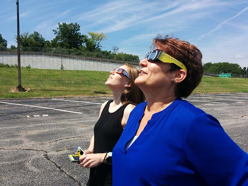 Employees in Elsevier's St. Louis office watch the eclipse. (Photo by Jeffrey Bryant)