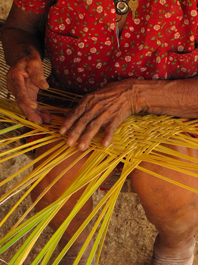 "Bae Chavez of the Chácobo community ""Alto Ivon"" weaves baskets using palm leaves. (Photo by Narel Paniagua-Zambrana)"