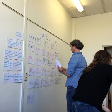 Figure 4: Organizing insights. Robbertjan Kalff posts his team's observations onto a white board.